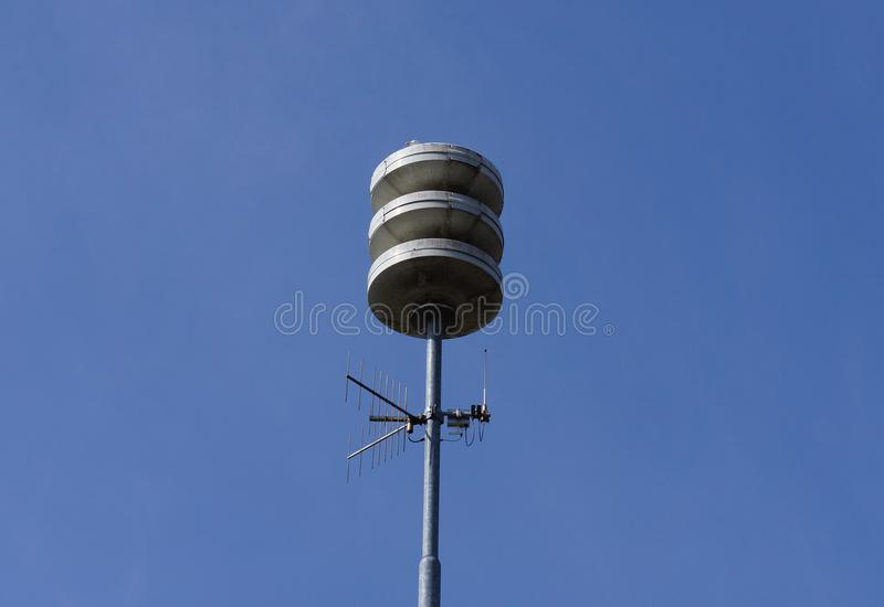 Civil defense siren installation in the Netherlands. Used to provide emergency population warning of approaching danger. The Netherlands tests its air-raid stock photography