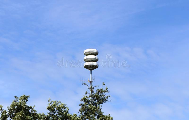 Civil defense siren installation in the Netherlands. Used to provide emergency population warning of approaching danger. The Netherlands tests its air-raid royalty free stock photo