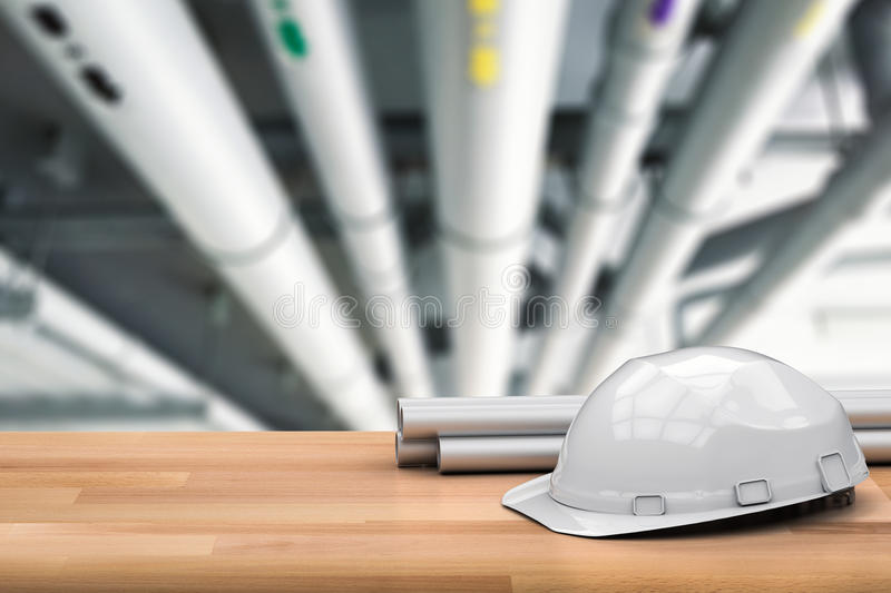 Civil engineer concept. With pipeline and white helmet royalty free stock images