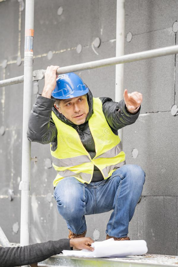 Civil engineer working on construction site stock photo