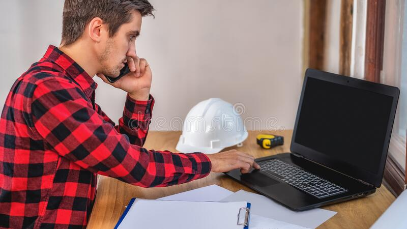 Civil engineer at his Desk working with documents stock photo