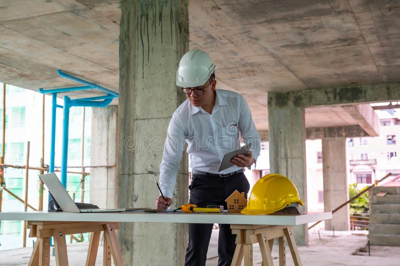 Civil engineer is inspecting in building site royalty free stock photography