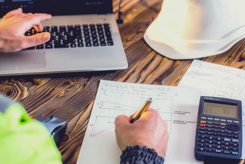 Civil Engineer making Structural Analysis Calculations stock photos