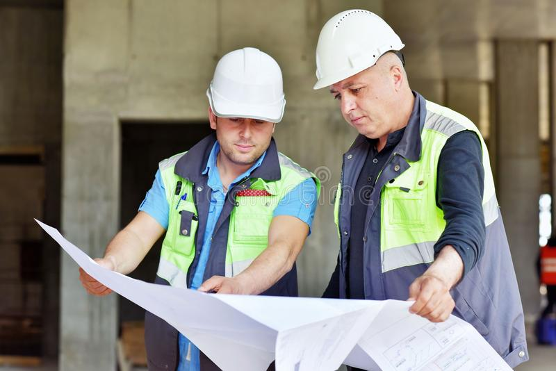 Civil Engineer And Senior Foreman At Construction Site royalty free stock photography