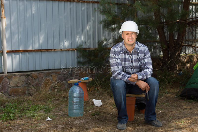 Civil Engineer Sitting at Construction Site Corner royalty free stock photo