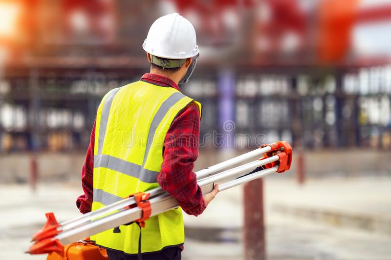 Civil engineer and survetor in building site. With measure tool and construction background. this photo canuse for engineer, job, work and job concept stock images