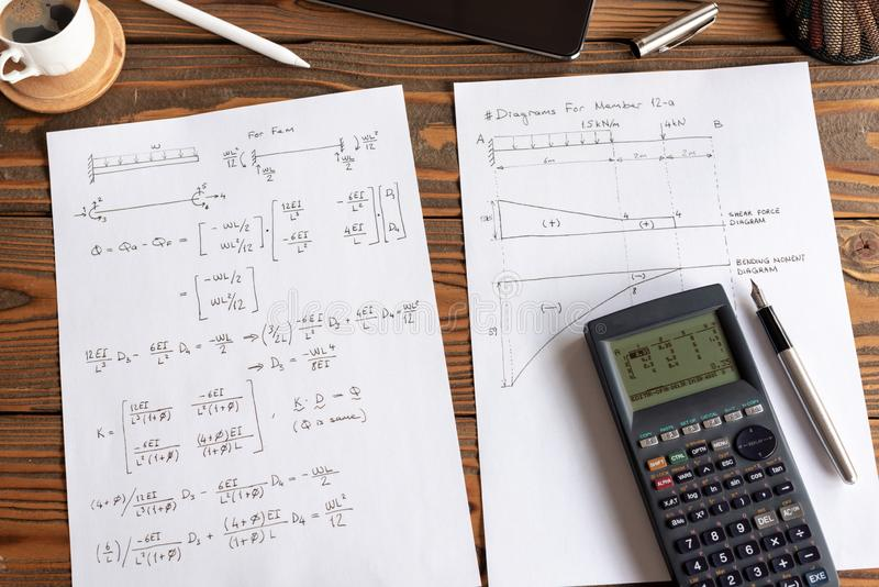 Civil Engineer or University Student Making Calculations Using Calculator royalty free stock photos