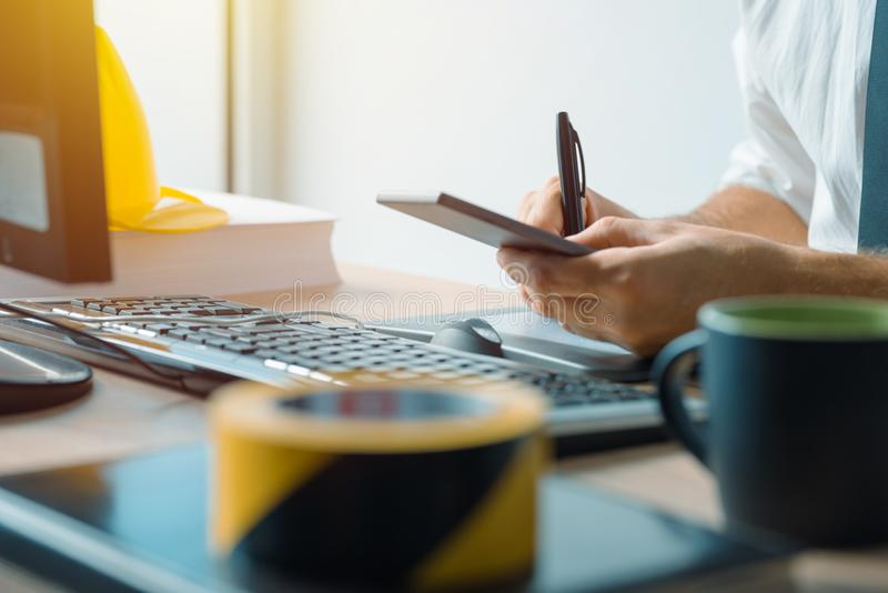 Civil engineer using smartphone in office royalty free stock photos