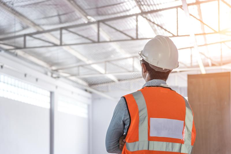 Civil engineer wear safety suite. And safety helmet working at construction site stock image