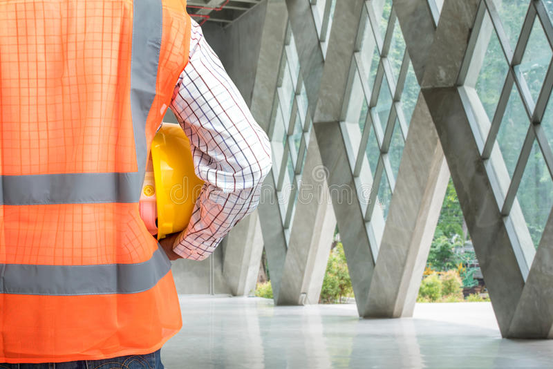 Civil engineer working in building construction site royalty free stock image