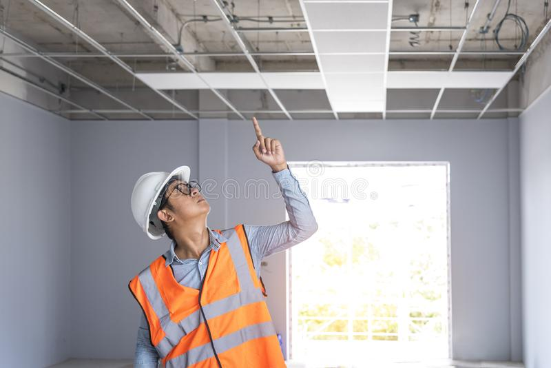 Civil engineer working at construction site. Civil engineer wear safety suite and safety helmet working at construction site royalty free stock image