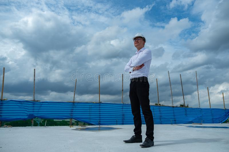 Civil engineering manager is standing and looking to his successful royalty free stock images