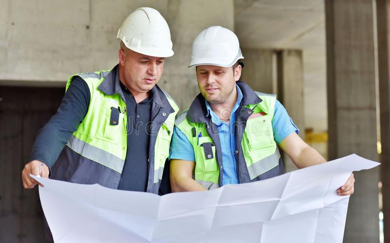 Civil Engineers At Construction Site stock image