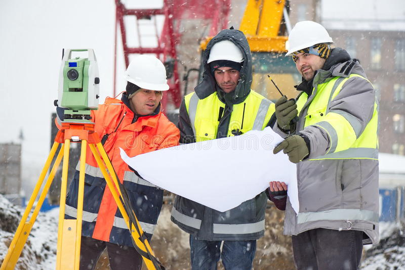 Civil engineers at construction site royalty free stock image