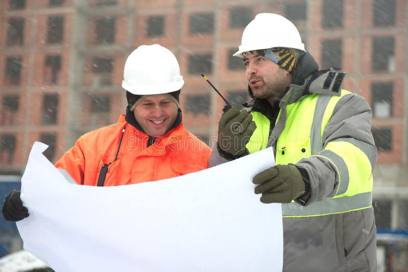 Civil engineers at construction site in winter season stock photos