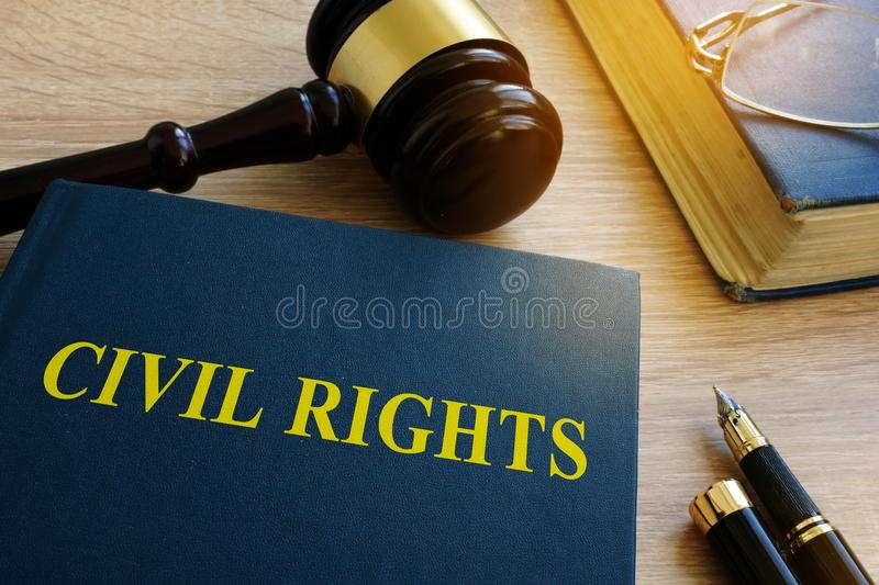 Civil rights code in a court. Civil rights code and gavel in a court stock photography