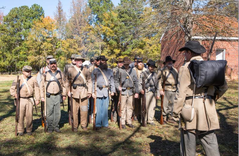 Civil War Army Roll Call. MCCONNELLS, SC USA - November 3, 2018: Confederate troops stand at attention during a Civil War battle reenactment at Historic royalty free stock images