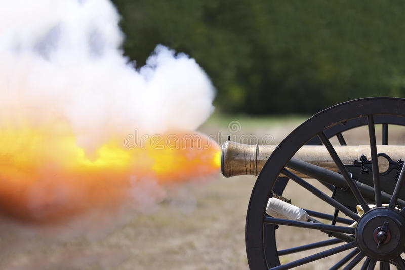 Civil War Cannon Fireing. A close up shot of a Civil War cannon firing at a civil war re-enactment stock photo
