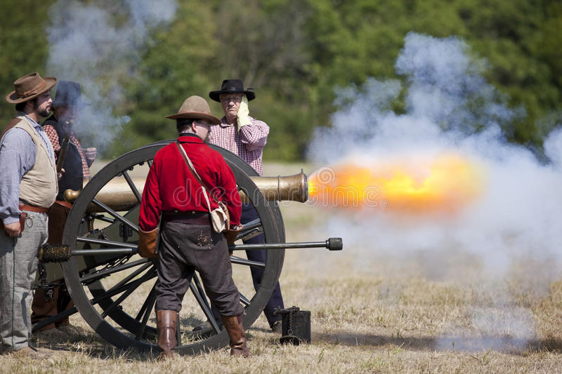Civil War Cannon Firing. Battlefield, Missouri, USA - August 11, 2012: Civil war re-enactors fire off a cannon at Wilson's Creek National Battlefield Park in royalty free stock photos