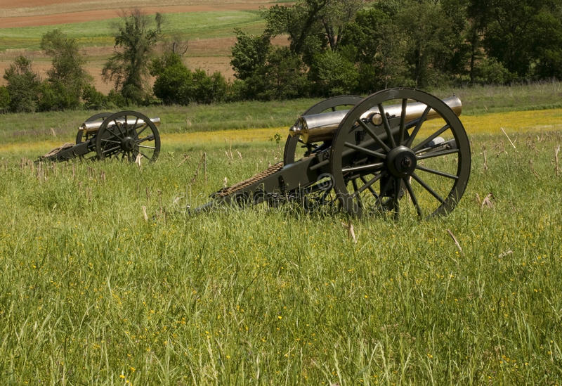Civil war cannons in the field. A pair of civil war cannons in the field ready for battle royalty free stock images