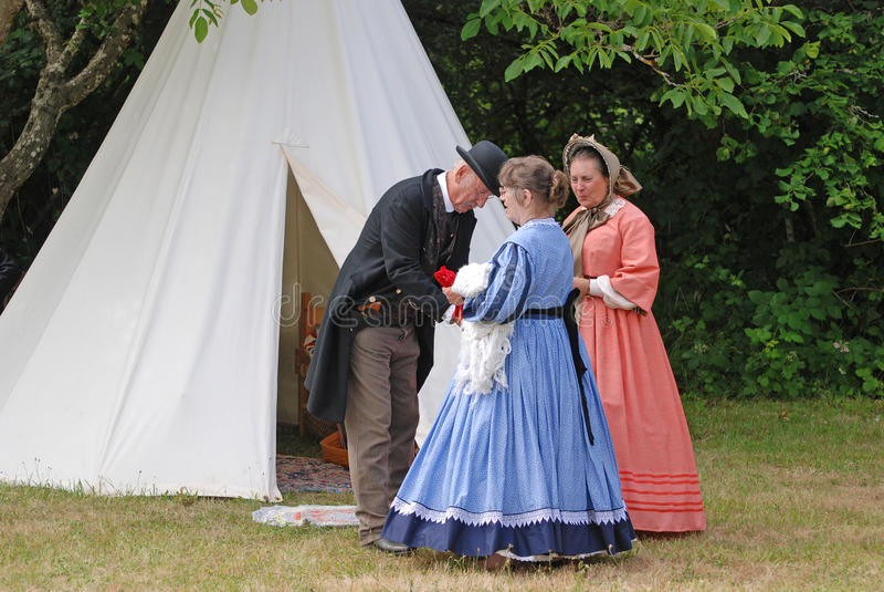 Civil War preacher with two ladies. stock photos