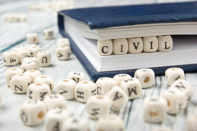 CIVIL word written on wood block. Wooden ABC royalty free stock photography