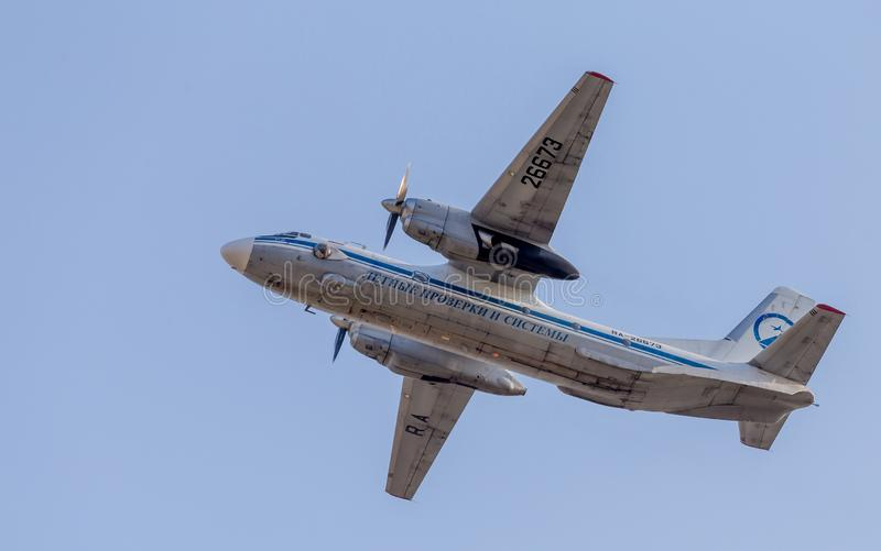 Civilian jet Antonov An-26 NATO reporting name: Curl aircraft in blue sky. Airplane`s fuselage. Aviation and transportation royalty free stock photography