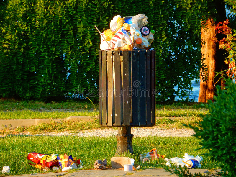 Civilization. Garbage overflowing in a beautiful park stock images