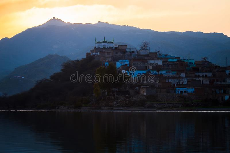 Civilization near water. Rural area villages houses lake river royalty free stock photo