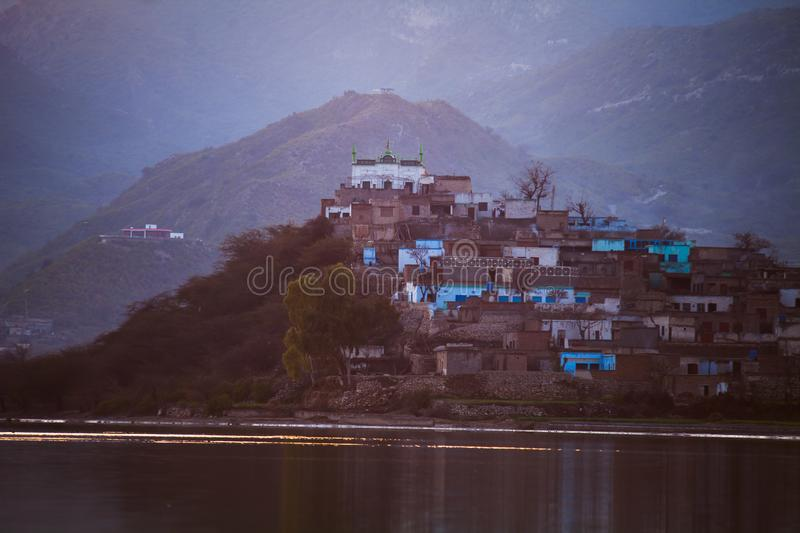 Civilization near water. Rural area villages houses lake river royalty free stock images