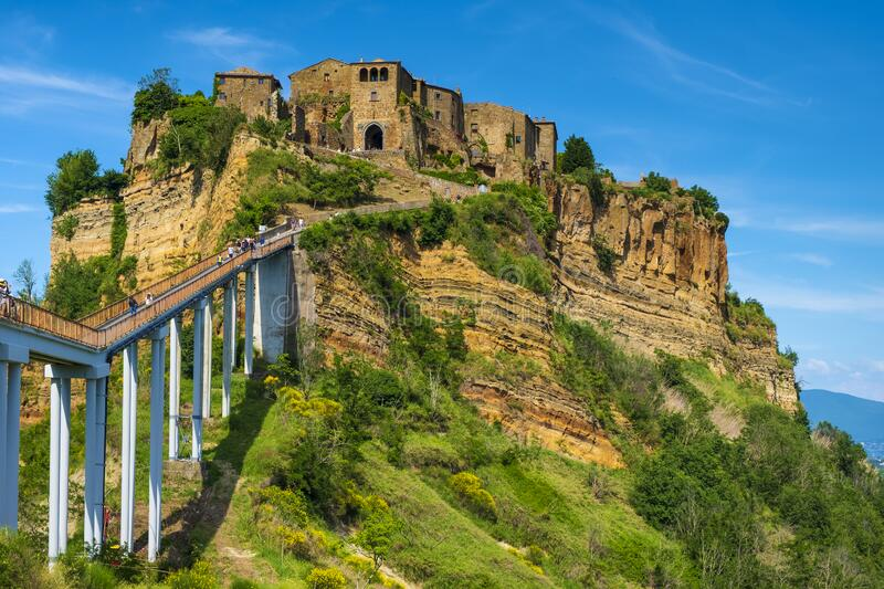 Civita di Bagnoregio, Italy - Panoramic view of historic town of Civita di Bagnoregio with a connecting bridge and surrounding. Civita di Bagnoregio, Lazio / stock photos