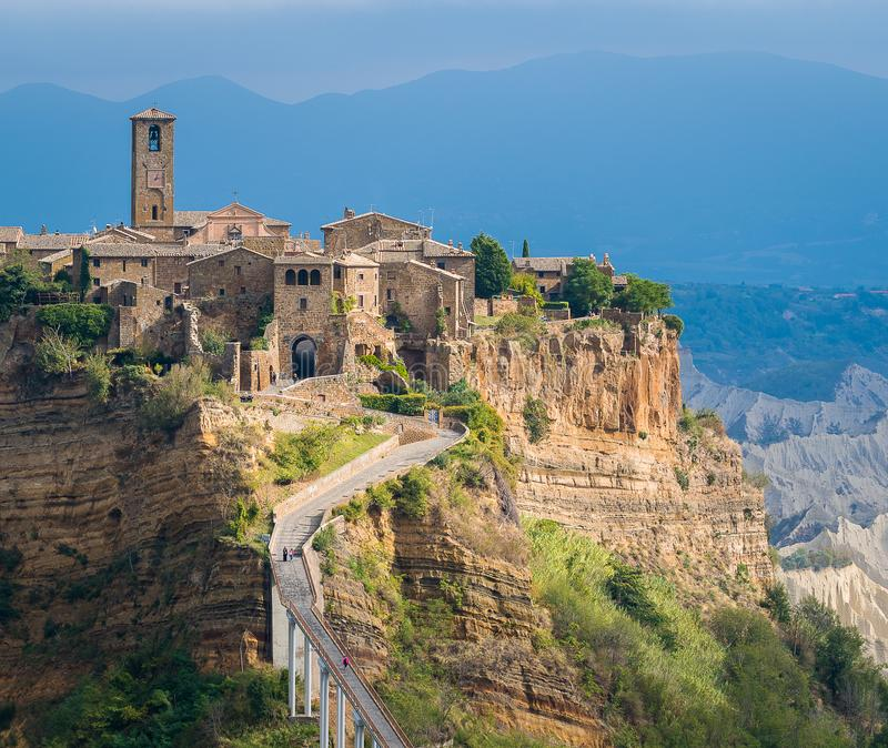 The famous Civita di Bagnoregio hit by the sun on a stormy day. Province of Viterbo, Lazio, Italy. royalty free stock image