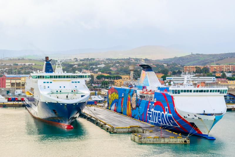Grimaldi Lines and Tirrenia Athara ferries at the Port of Civitavecchia, Rome. Civitavecchia, Italy - November 5, 2018: Grimaldi Lines and Tirrenia Athara stock photo