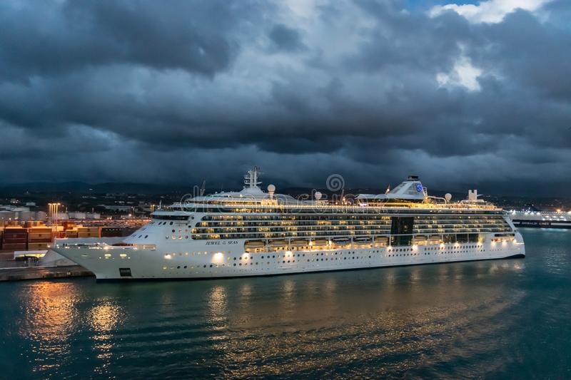 Royal Caribbean Cruise Line Jewel of The Seas Cruise Ship docked in the Port of Rome on a rainy night. royalty free stock images