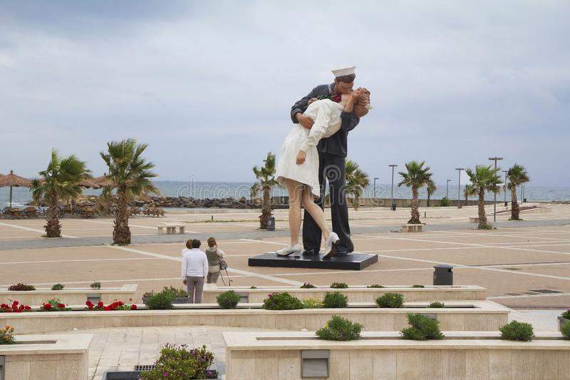 Civitavecchia, Italy, the Statue `Unconditional surrender` on the waterfront. The famous statue of two kissing lovers sailor and nurse on the waterfront of royalty free stock image