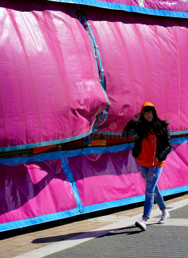The girl in the pink tent stock photos