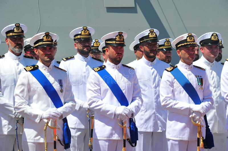 Civitavecchia Rome Italy Some sailors from the Italian Navy deployed under the Alpine Warship waiting for the authorities for Day. Of the Italian Navy stock image
