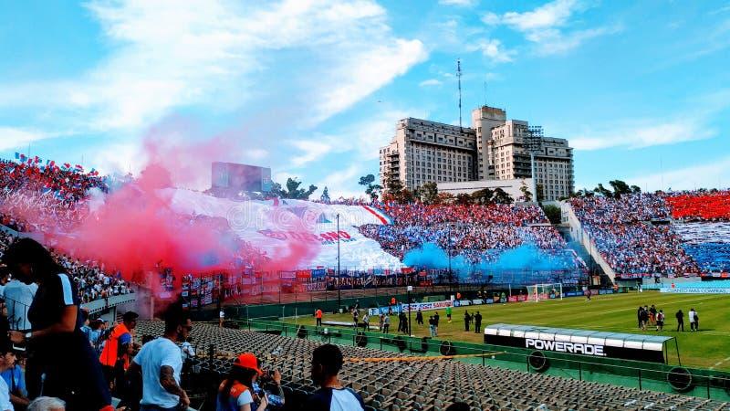 Clásico del fútbol uruguayo, hinchada de Club Nacional de FootBall. Hinchada del hinchada de Club Nacional de FootBall. en la tribuna para el clásico stock photo
