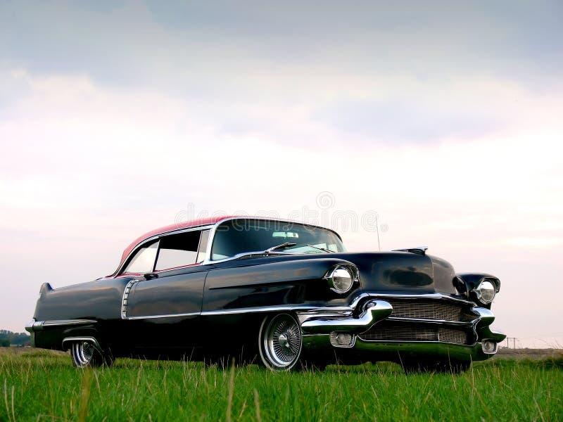 Clássico americano - carro preto dos anos 50 imagem de stock royalty free