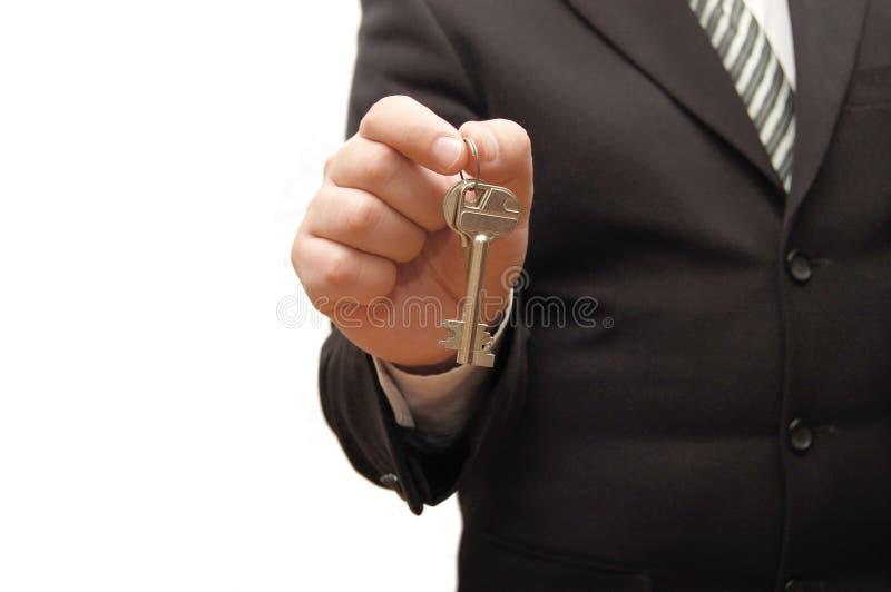 clé de fixation de main d'homme d'affaires photo libre de droits