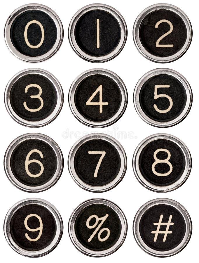Clés de numéro de machine à écrire de cru images stock