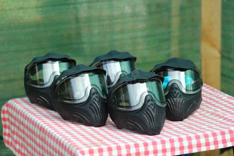 Clôture du jeu de paintball combat masques de protection plein visage photos stock