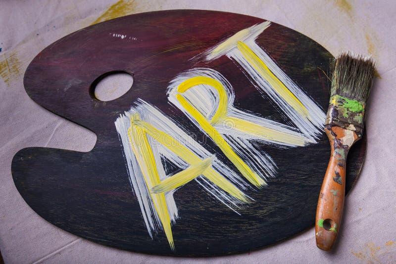 Clôturez l'ART peint sur la palette en bois de peinture d'artiste photo libre de droits