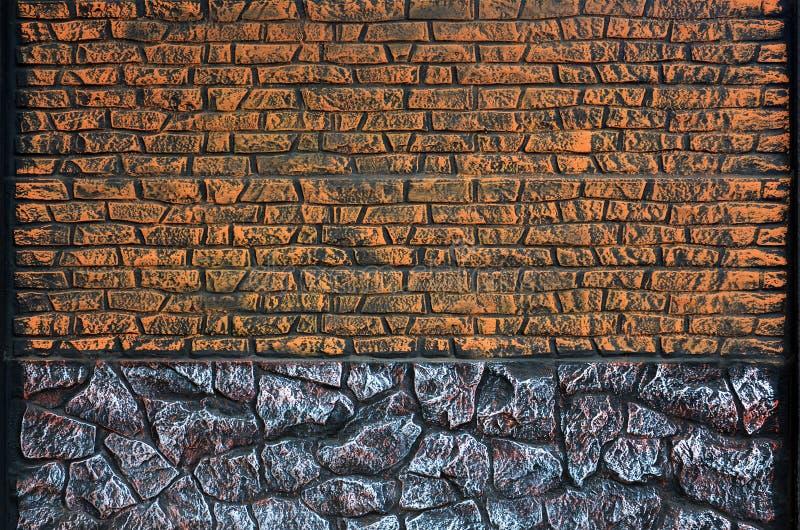 Clôturez la texture des pierres colorées ovales des couleurs chaudes Weathered a souillé le type moderne de barrière Wal concret  photo libre de droits