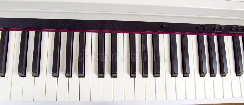 Cl?s ?lectroniques de piano Passe-temps d'instruments de musique photo stock