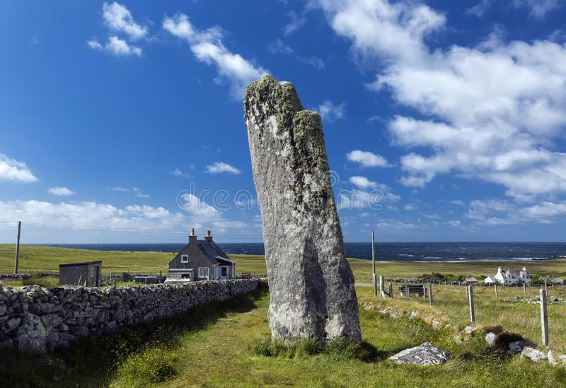 Clach an Trushal Thrushel Stone on NW coast of Isle of Lewis is one of the most impressive standing stones in Scotland. Clach an Trushal Thrushel Stone on NW royalty free stock photography