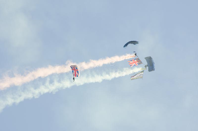 British Army Parachutists descending over Clacton free airshow stock photo