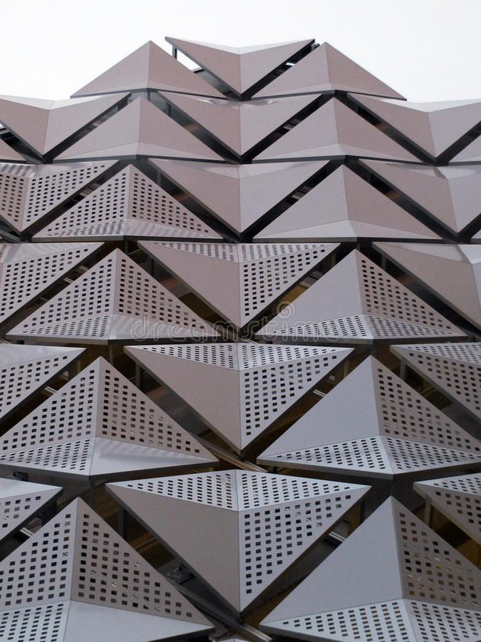 Cladding on geometric modern steel building detail royalty free stock image