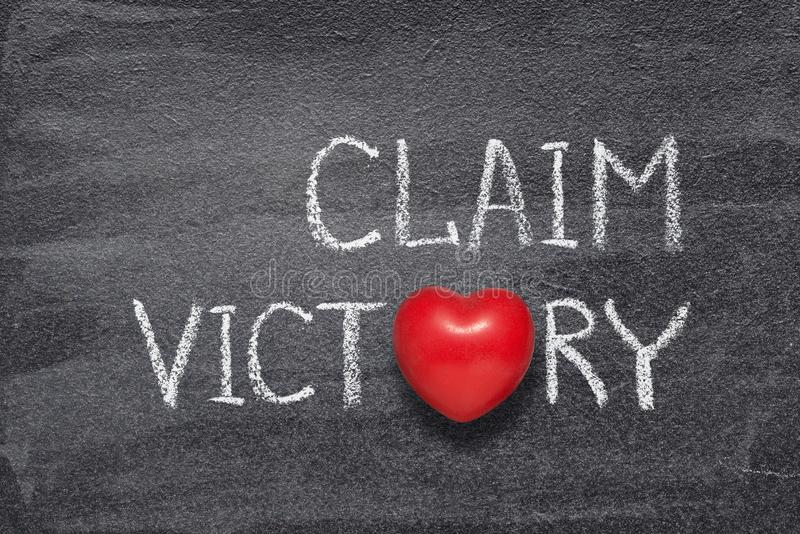 Claim victory heart. Claim victory phrase written on chalkboard with red heart symbol royalty free illustration