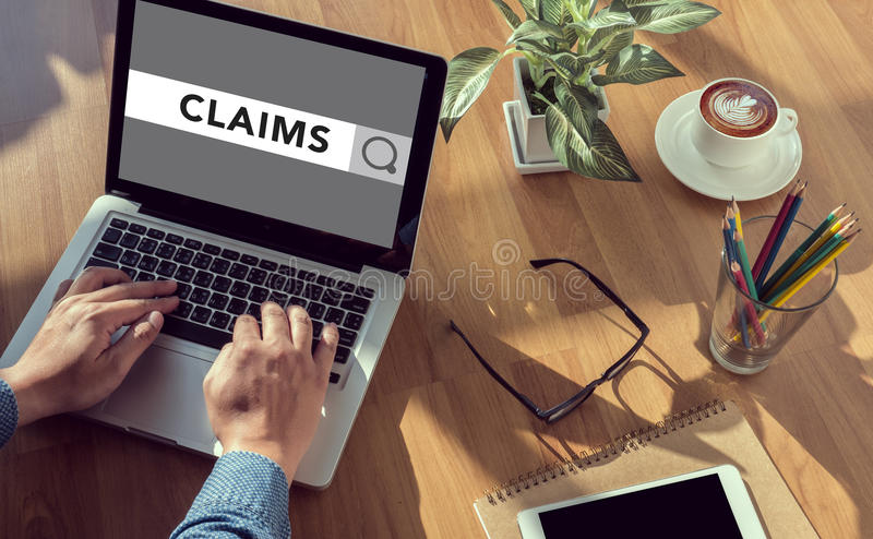 CLAIMS CONCEPT. Man hand on table Business, coffee, Split tone royalty free stock photo